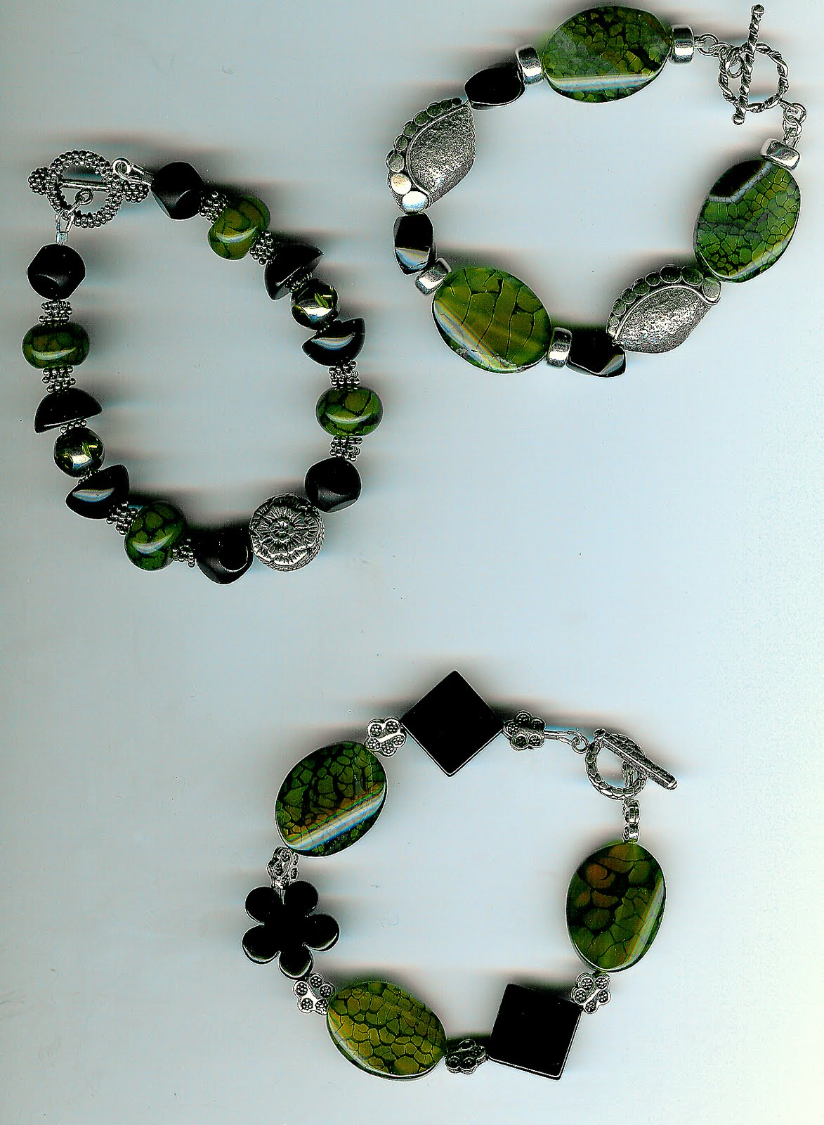 125. Olive Agate, Onyx and Bali Sterling Silver