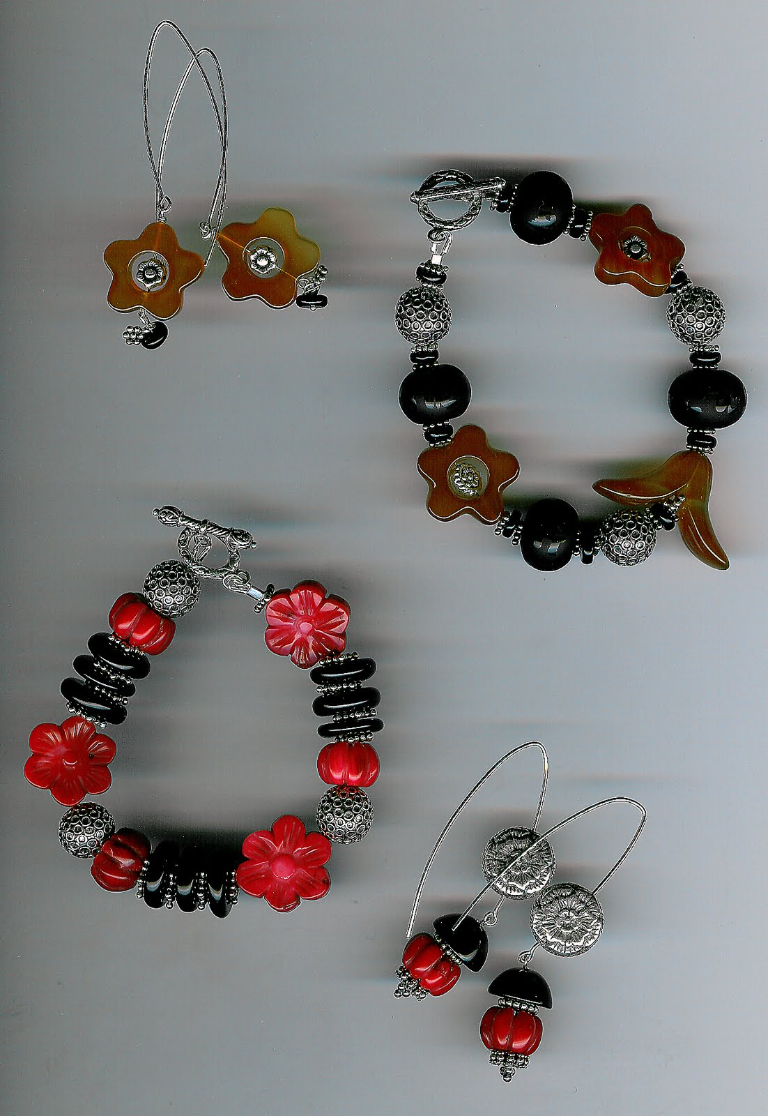 123. Carved carnelian and coral, with onys and Bali Sterling Silver