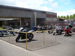Several motorcycles in a designated motorcycle parking area.