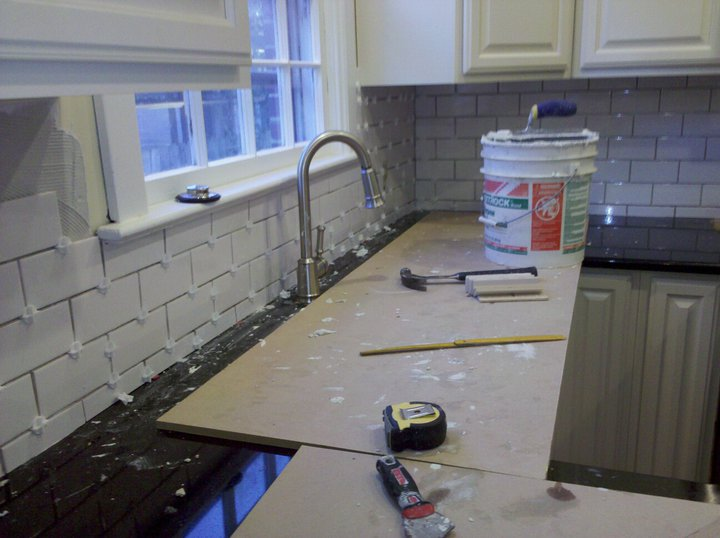 girl 39 s guide to home renovation kitchen tile backsplash install