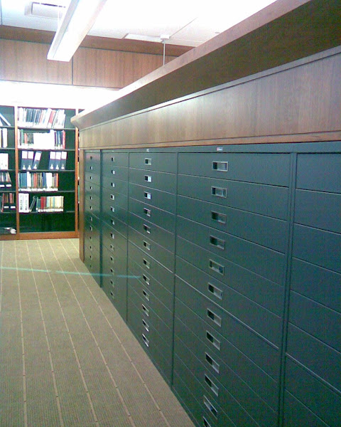 60!!  Count them, 60 microfilm drawers!