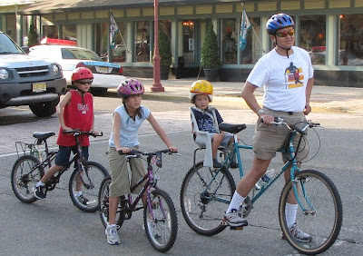 Image of bicycling family