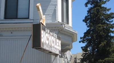Image of bike shop sign in Oakland