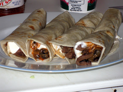 Wrap bean & meat in tortilla with sour cream and hot sauce