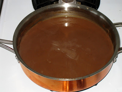 Cook chili sauce to reduce