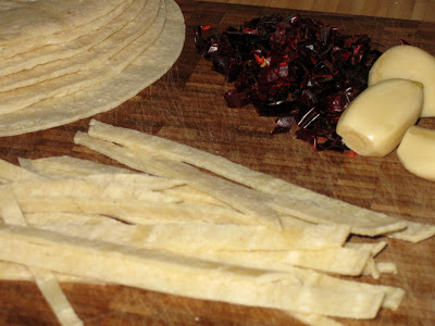 Cut corn tortillas into strips and fry
