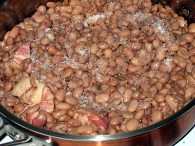 Drain cooked beans and fry in olive oil