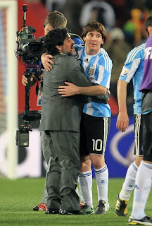 Argentina's head coach Diego Maradona congratulates Lionel Messi after victory in 2010 FIFA World Cup South Africa Group B, Match between Argentina and Nigeria at Ellis Park Stadium on June 12 in Johannesburg, South Africa.