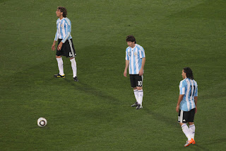 Lionel Messi of Argentina's national football team lines up a free kick with teammates Heinze and Tevez during 2010 FIFA World Cup South Africa Group B, Match between Argentina and Nigeria at Ellis Park Stadium on June 12 in Johannesburg, South Africa.
