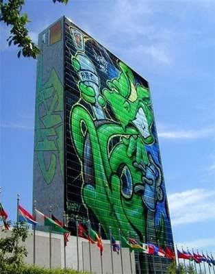 Painting Graffiti Alphabet in Green Building