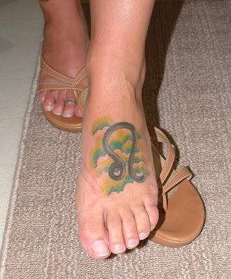 Leo symbol tattoos female for Girl symbol tattoos