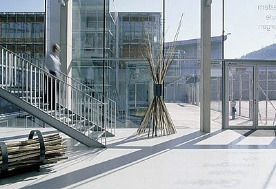entrance to modern building with sculpture