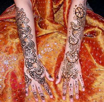 Intricate patterns of mehndi are typically applied to brides before wedding