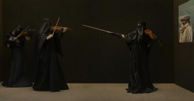 Klicka på violinen eller  burkan