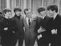 Os Beatles com Ed Sullivan em 1964