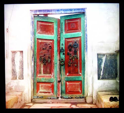 Red and green double doors with blue trim