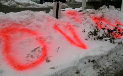 Red spray-painted word DVDs on a snowbank