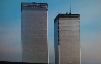 Camera pulls back in helicopter shot to reveal the Twin Towers