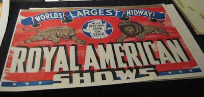Red Royal American Shows circus poster with a lion and tiger leaping