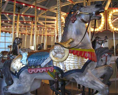 Carousel horse with a sword and shield on its side