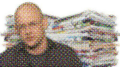 Clay Shirky in front of a pile of newspapers, rendered in half tone dots
