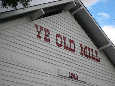The Ye Old Mill sign at the top of the building, with 1913 written below
