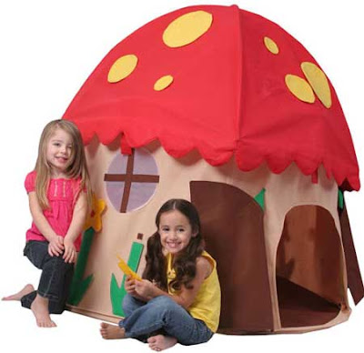 Two little girls outside a cartoonish tent resembling Amanita muscaria