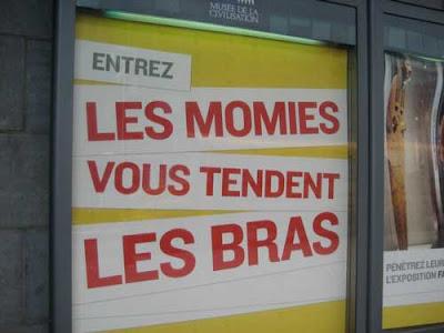 Poster that says Entrez - Les Momies Vous Tendents les Bras