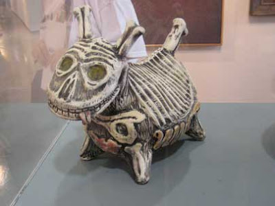 Ceramic sculpture of a dog made of bones, similar to Nightmare Before Christmas