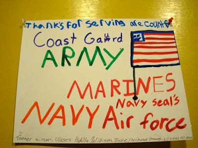 Hand-written sign by children thanking 'are' service members