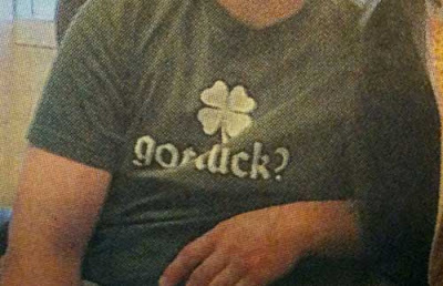 Closeup of boy's t-shirt, which looks like it says Got dick? but probably says Got luck?