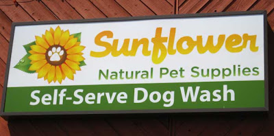 Natural pet supply store sign with tagline, Self-Serve Dog Wash