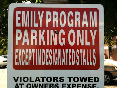 Restricted parking sign with letters so condensed they are unreadable