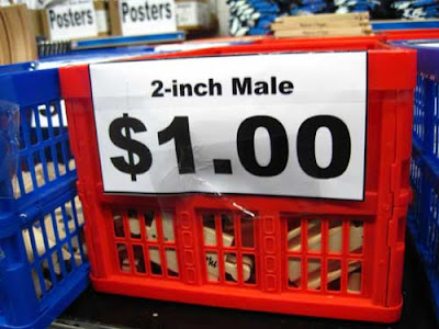 Red basket with small sign labeled 2-inch male $1.00