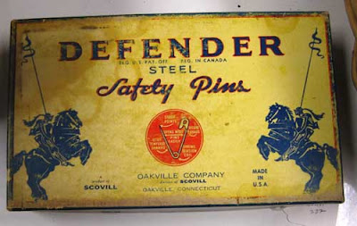 Antique safety pin box, named Defender Safety Pins with illustrations of knights on horseback