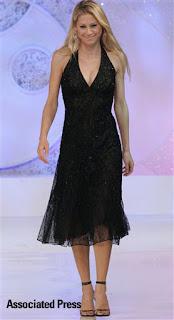 Anna Kournikova in a little black dress