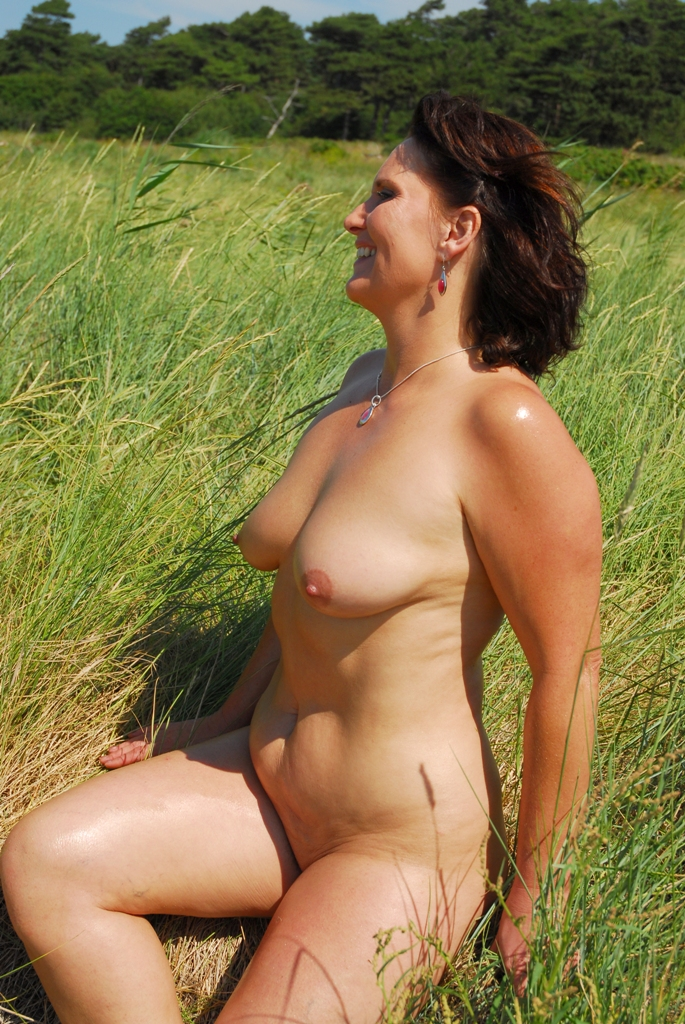 mature and young nudist woman