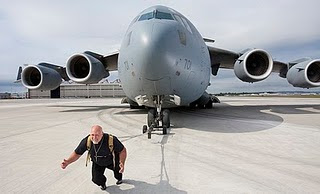 World Heaviest Plane Pulled photo, World Heaviest Plane Pulled video, New Guinness World Records 2011, latest Guinness Records 2011, Current World Records 2011, Funny ginis records 2011, Recent guinis world record 2011, 2011 Guinness world records