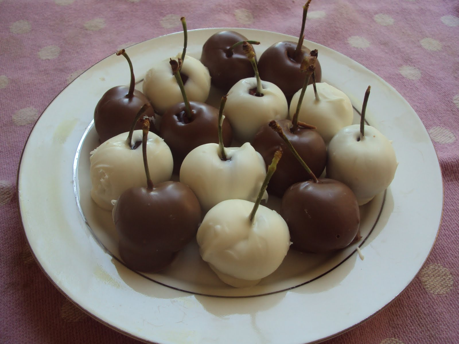 Fresh cherries dipped in white & milk chocolate; available only when ...