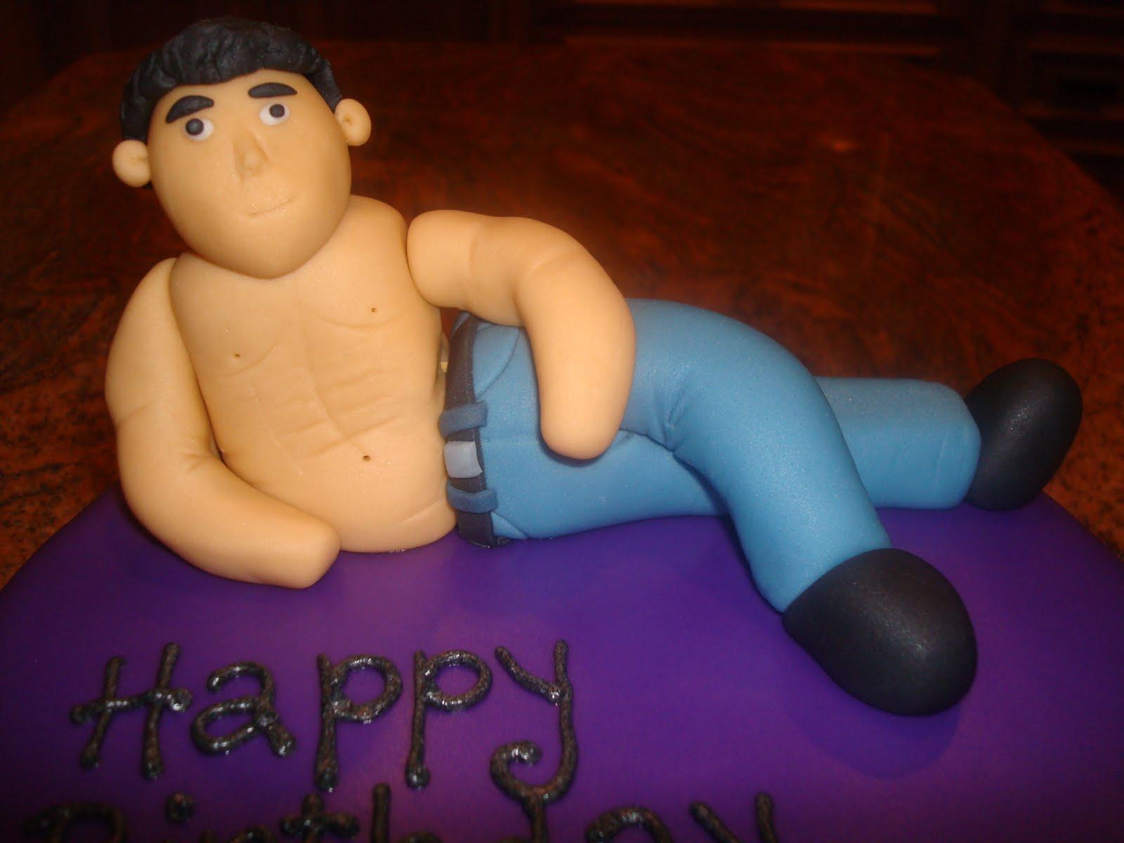 Hot man with birthday cake