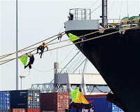Greenpeace activists on the Nyk Orion mooring lines