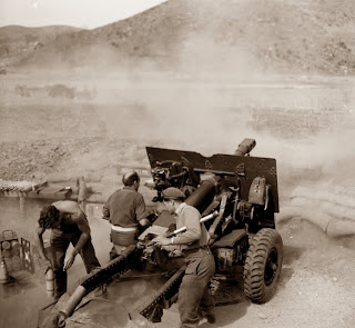 Dad in action, Korean War, April 1952 - he's the gunlayer sitting down...