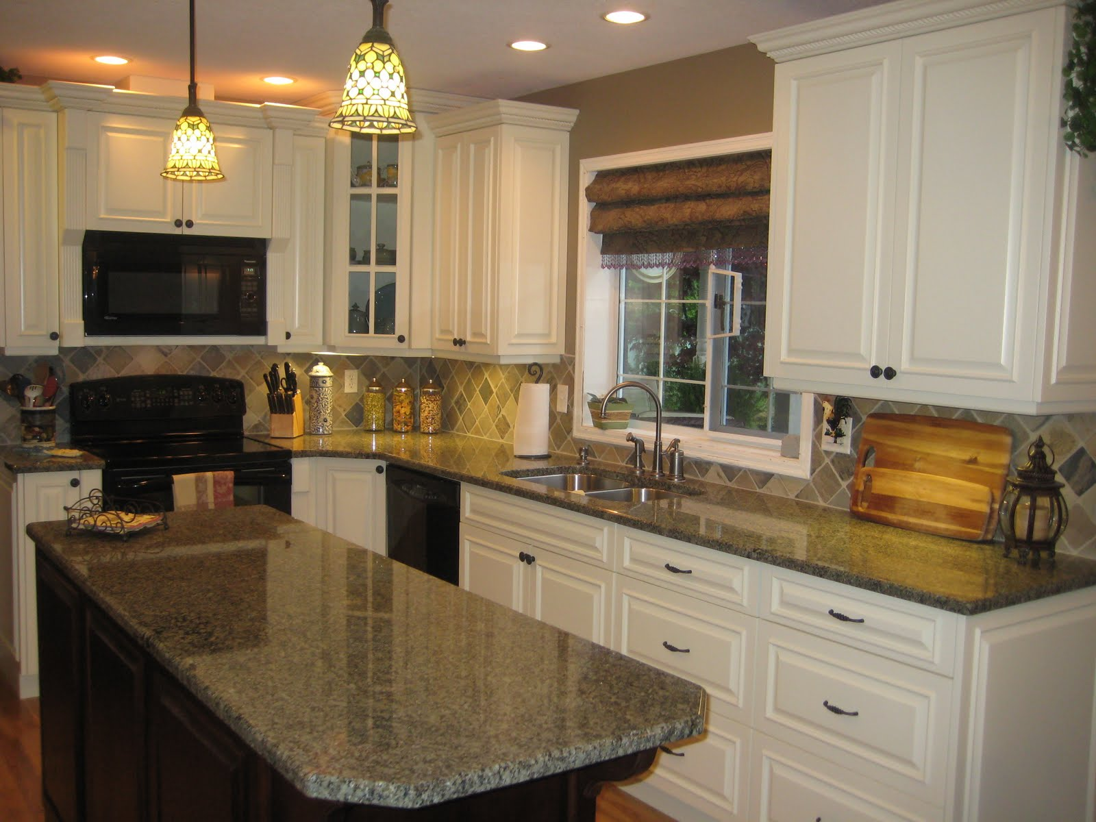 Cream Kitchen Cabinets with Dark Island