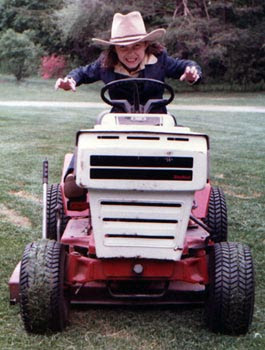 ~9 year old Claire mowing the lawn 1