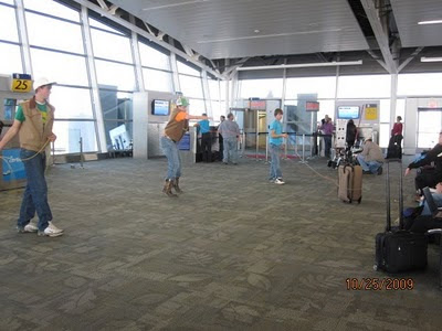 Rodeo Cowboys roping suitcases at the Indianpolis airport