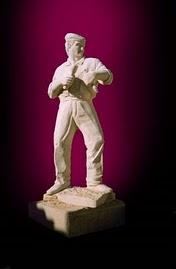 Suor e talento, escultura em granito de tamanho natural