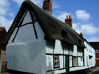 A cruck-framed thatched cottage