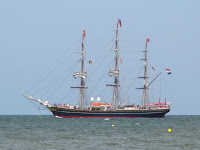 A tall ship leaves port