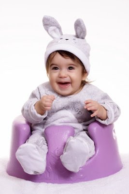Smiling baby sit on the air chair