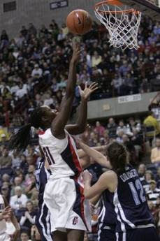 Connecticut's Tina Charles, left, takes a shot as Villanova's Kyle Dougherty guards